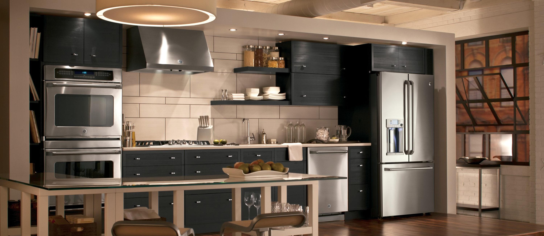 Black appliances in kitchen Photo - 9