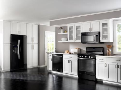 Black appliances in kitchen Photo - 10