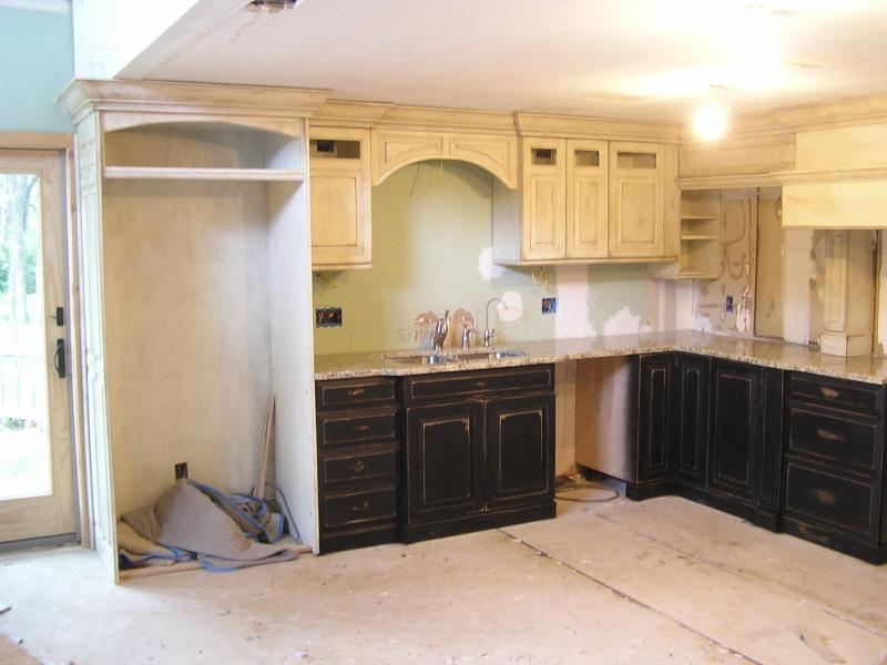 Black appliances in kitchen Photo - 11