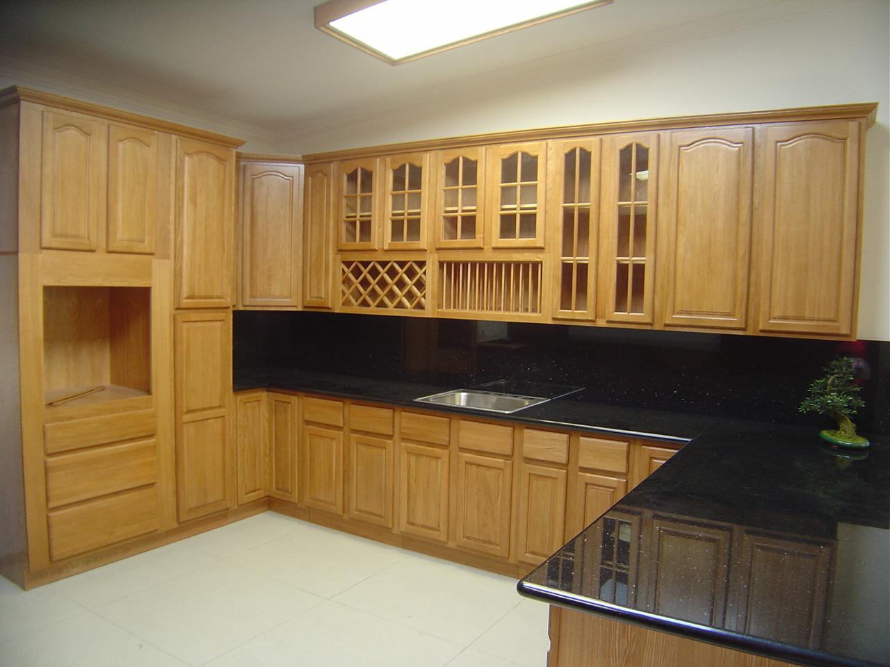 Black appliances in kitchen Photo - 12