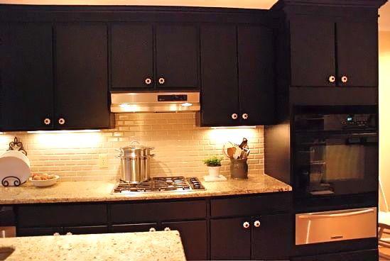 Black appliances in kitchen Photo - 2