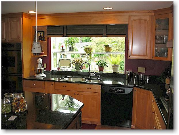 Black appliances in kitchen Photo - 4