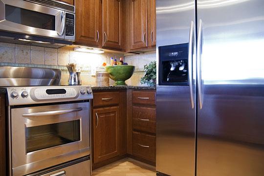 Black appliances in kitchen Photo - 6