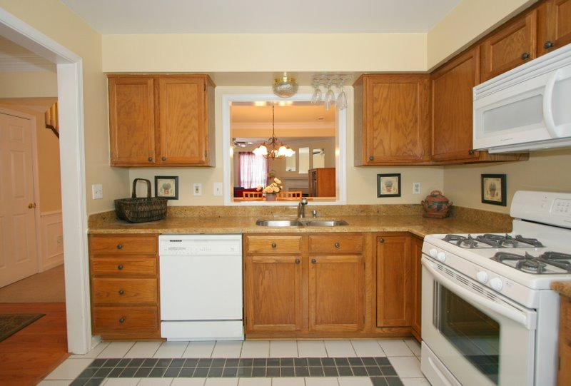 Black appliances in kitchen Photo - 7