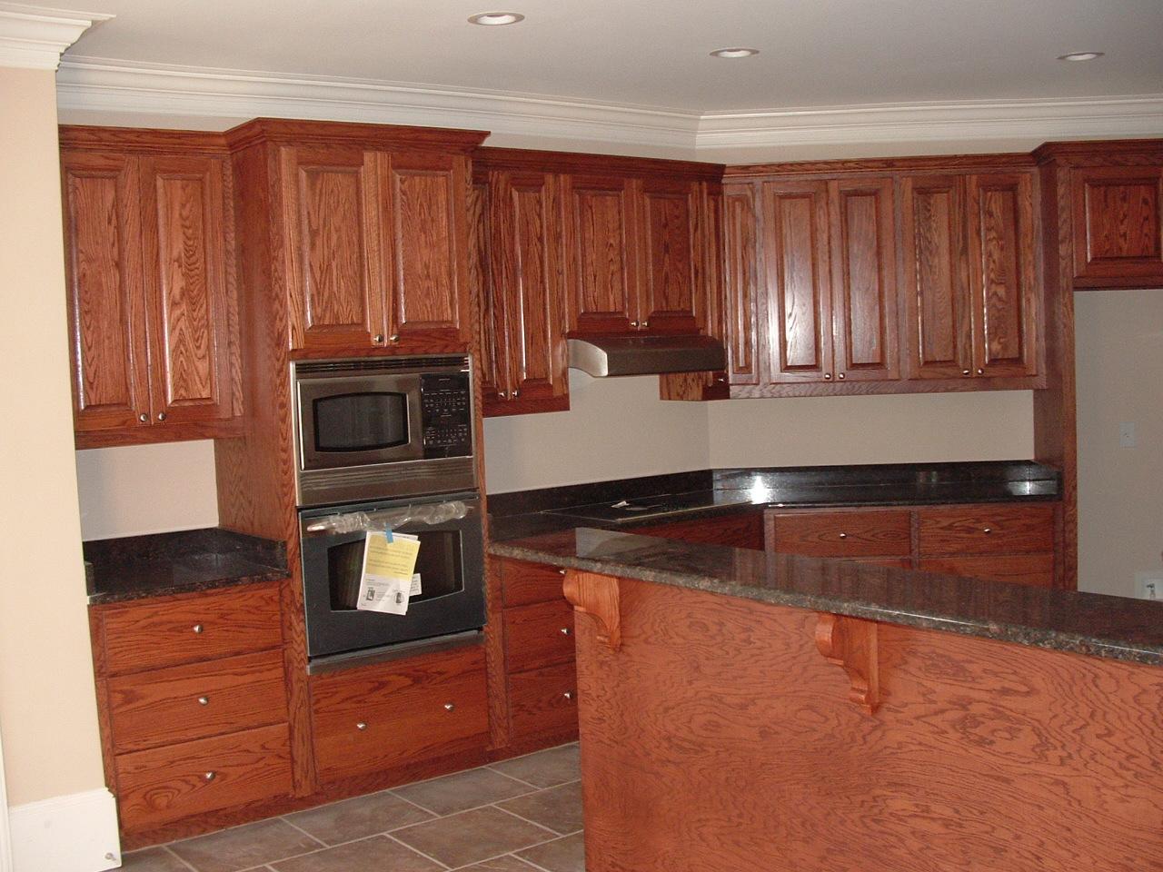 Black kitchen storage cabinet Photo - 1