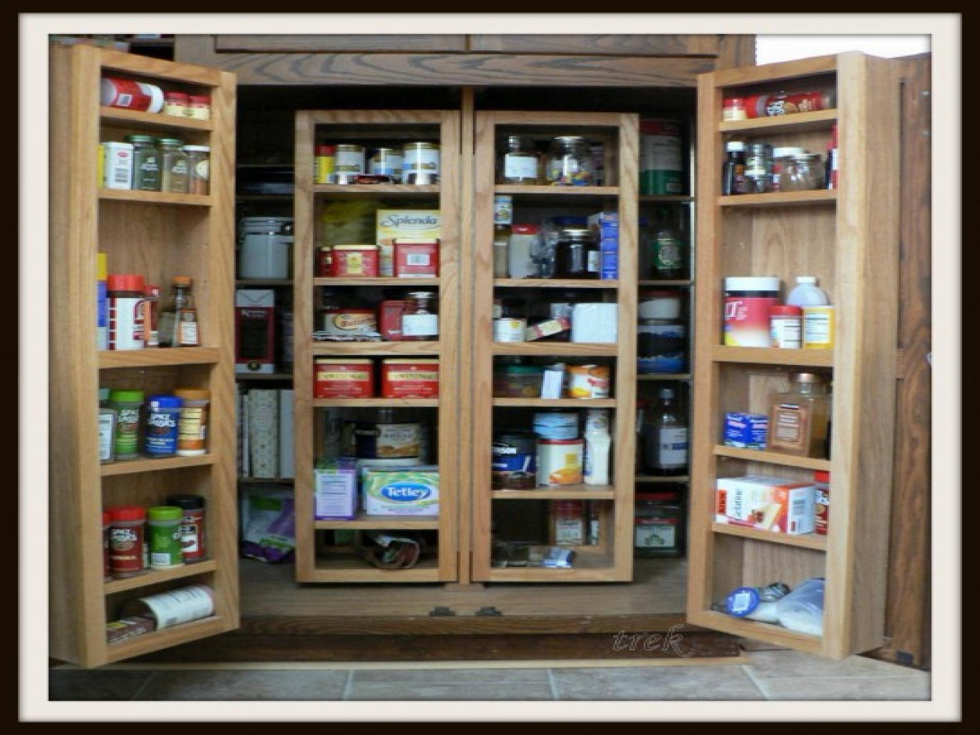 Tall kitchen storage cabinet Photo - 7
