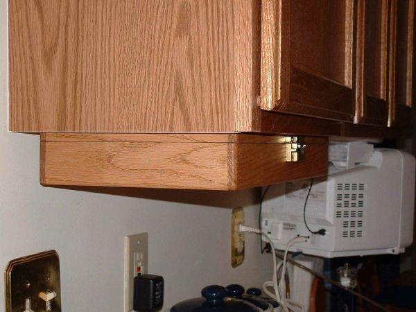 Under kitchen cabinet storage Photo - 12