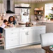 White kitchen island with stools Photo - 1