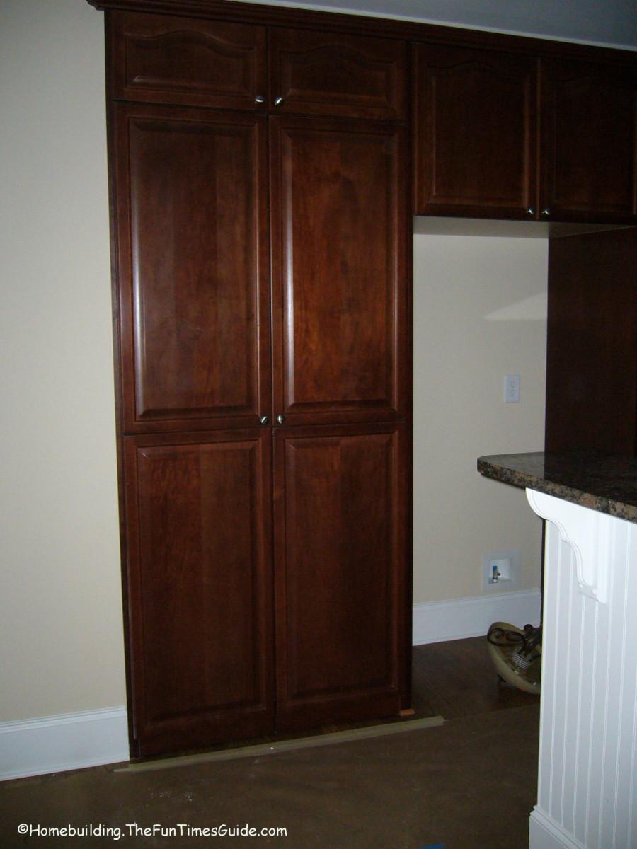 Wood kitchen pantry cabinet Photo - 7