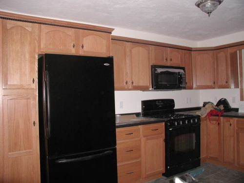 Black kitchen appliances photo - 1