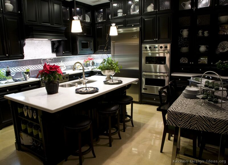 Black kitchen island with stainless steel top photo - 1