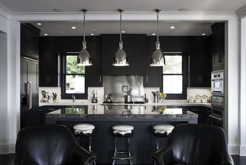 Black kitchen island with stainless steel top photo - 3