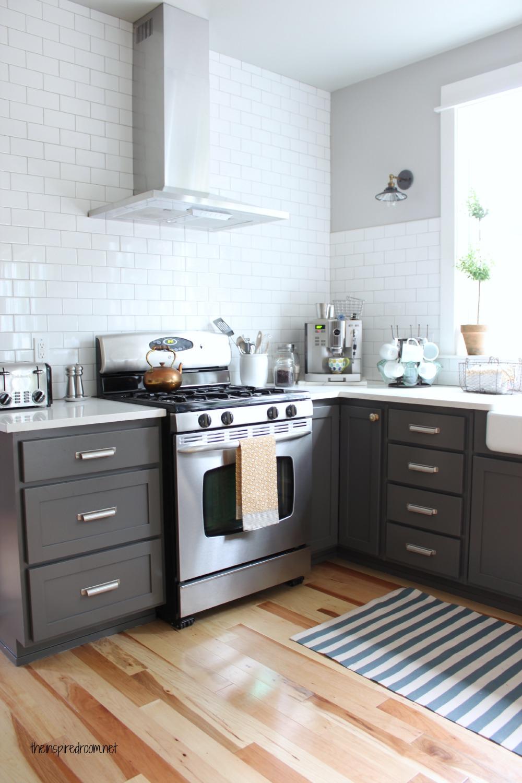 Black kitchen island with stools photo - 1