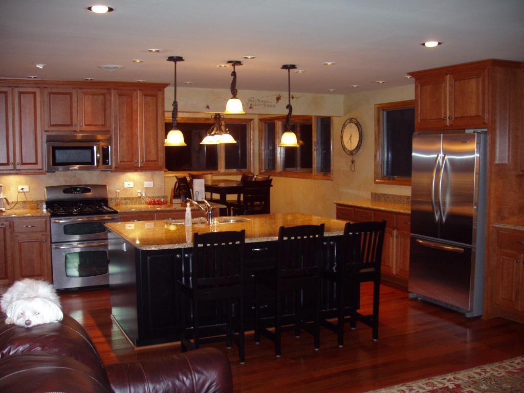 Black kitchen island with stools photo - 3