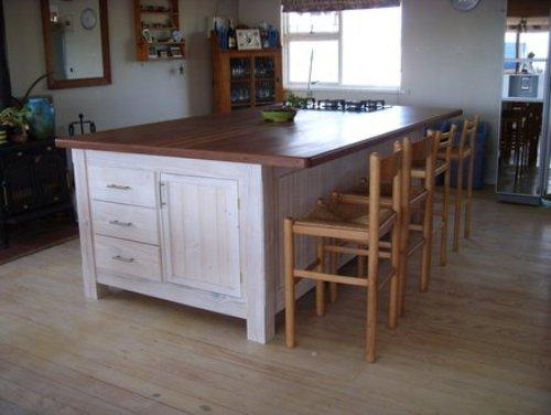 Kitchen island with storage and seating photo - 1
