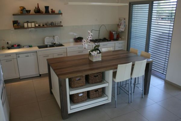 Kitchen island with storage and seating photo - 2