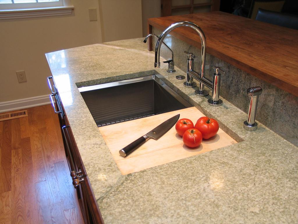 Kitchen sink with cutting board photo - 1