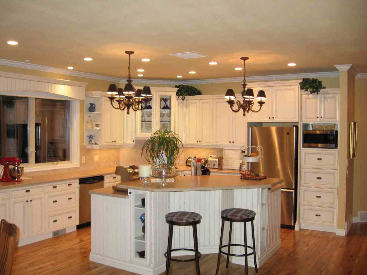 White kitchen island with stainless steel top photo - 2